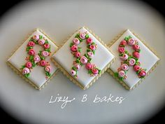 Rose Pink Ribbon cookies. I am neither this talented nor this patient, but they're pretty to look at!
