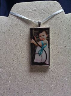 Adorable keepsake...baby's hair with picture in epoxy