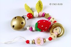 Pacifier dummy chain strawberry is the perfect gift for baby present and birth!All chains are made of non-toxic and approved beads. Pacifier...
