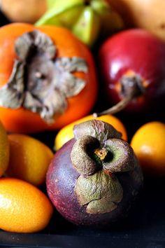 Back to front: pomegranate, carambole (star fruit), persimmon, tamarillo, kumquats & mangosteen