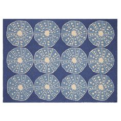 <p> This Blue Urchins Hook Rug brings calm symmetry to your coastal home with 12 perfectly lined blue urchins laid at your feet .