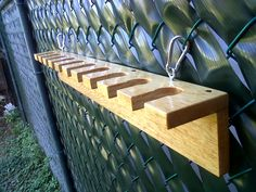 """This is my first Instructable...  (Comments Appreciated!) :D Materials you'll need: (note: click on links below for images of items) 1. Two wooden boards Aprox. (32""""'x 4""""x 3/4"""") 2. Five 2"""" wood screws 3. Two small Eye Screws 4. Two Keeper Spring Links 5. White glue or wood glue 6. Paint or transparent lacquer Tools I used: 1. Jigsaw 2. Drill 3. Rotary Tool 4. Sander 3. Drill bits 4. Hole saw 5. Screw bit 6. Tape measure 7. Combination square"""