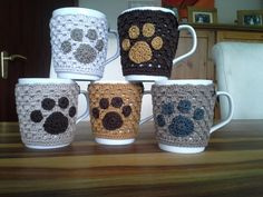 "Mugs & Cups - A cup with cup warmer ""paw"" nature - a unique product by Christine-Pelz Crochet Coffee Cozy, Crochet Cozy, Crochet Crafts, Yarn Crafts, Crochet Projects, Coffee Cup Cozy, Crochet Flower Patterns, Crochet Designs, Crochet Kitchen"