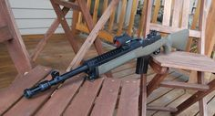 Ruger Mini 14 with hogue rifle stock and tactical rail.
