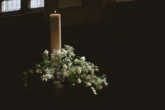 Olivier Burnside Fine Art Reportage Wedding Photographer. Wedding Flowers and Candle