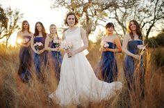 Bridal party group pose - bride in front, bridesmaids a feet back.  From Ryan Brenizer