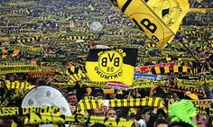 If I don't get a chance to see White Hart Lane (or the new stadium when it's completed) for Tottenham, I'd love to go to the Westfalenstadion, where Borussia Dortmund play.  Would be fun to attend a match there for sure.  =)