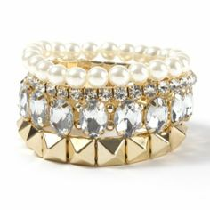 Dressy Stack Bracelets Set of 5 (#41220): Looking for a fun way to accessorize a formal or party look? This gorgeous set of 5 dressy stack braclets has something for everyone. The set includes bracelets with faux pearls, small and large rhinestones and gold-colored studs. Wear one or stack them all for a totally glamorous feel. Stretch fit. $12.50