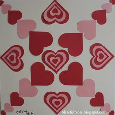 An art project for kids, but I think this would be great framed on the wall.  Symmetrical Valentine Art Project For Kids