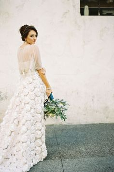 From our wedding experts at Style Me Pretty, real brides who skipped the traditional all-white gown route for a fashion-forward bridal look. Click through to see all of the stunning looks.