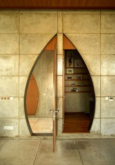 Indonesian architect Realrich Sjarief's fondness for geometric forms is expressed in the circular and arch-shaped windows of this house in Jakarta.
