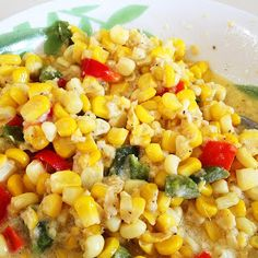Pioneer Woman's Corn With Red Bell Peppers & Jalapenos...mixed with butter & cream and baked in the oven.  So Yummy! Thank you Pioneer Woman!