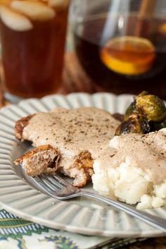 Fried pork chops + creamy homemade gravy = heaven! These Country-Fried Pork Chops are ridiculously delicious. This is one of the best dinner recipes you'll ever try.