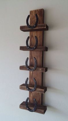 Make a little bigger with horseshoes on the side for towel storage. Or for a wine rack