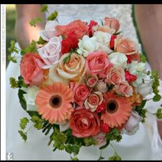 Coral daisy+ movie star rose bouquet.... for the bride... I like the coral, but I'd like a little more white