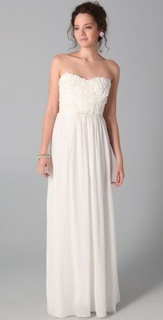 Simple wedding dress. Love the heart-shaped neckline