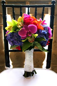Tropical style blue, green, purple, orange, and hot pink bridal bouquet