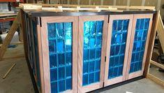 Corner folding door unit designed and setup for testing inside the Door Innovations shop. Folding Patio Doors, Innovation, Corner, Windows, Glass, Wall, Shop, Design, Home Decor