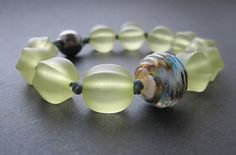 Love the lampwork . love the light green . knotted on waxed cotton! Beading by Malin de Koning Diy Jewelry Tutorials, Jewelry Ideas, Lucid Dreaming, Bracelet Designs, Bead Weaving, Stretch Bracelets, Handmade Bracelets, Gemstone Beads, Beaded Jewelry