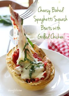 Cheesy baked spaghetti squash boats with grilled chicken from Skinny Taste