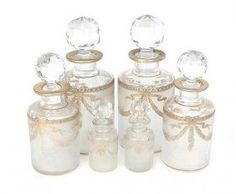 Baccarat gilt-decorated and etched glass toiletry