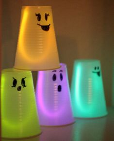 glowing ghosts with plastic cups. Great for kids Christmas parties