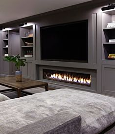 When it comes to outfitting the ground floor in your home, a basement fireplace will up the ante. We're talking instant warmth and ambiance. Here are eight basement fireplace ideas to inspire your decor. Basement Fireplace, Basement Flooring, Fireplace Ideas, Fireplace Remodel, Basement Bathroom, Flooring Ideas, Fireplace Console, Tv Over Fireplace, Paneling Ideas