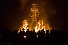 The Man burns before a crowd of tens of thousands on the penultimate night of Burning Man 2015. (Photo by Scott London)