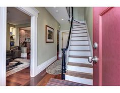 A winding staircase takes you up as you enter the front door