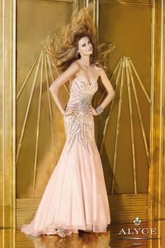 Strapless beaded tulle mermaid prom dress by Alyce Paris.