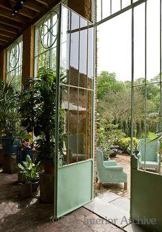 A view of the garden through the metal door of the conservatory.  (In Belgium)