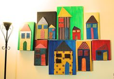 Bright and colorful easy recycle diy project for your gallery wall. I cut old cardboard boxed to created houses, windows and doors. Then I painted them with acrylic and pasted them on old shoe box covers which were also painted with acrylic paint. These can be easily extended or removed.