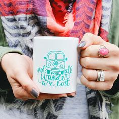 Enjoy your morning coffee (or tea) with our Not All Who Wander Are Lost coffee mug! White mug with turquoise ink. *Microwave and dishwasher