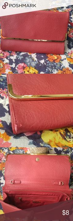 Red purse Stylish red purse...relatively with some scratches on one end( as shown in picture) not visible unless scrutinize closely. Looks good as new...# make an offer# like dreams Bags Clutches & Wristlets