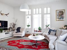 Accented rug with white furniture.