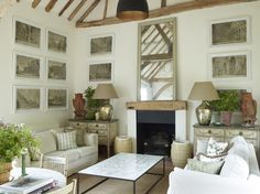 Framed architectural illustrations symmetrically hung | interior by Nicholas Haslam
