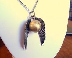 golden snitch locket <333