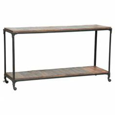 "Crafted from reclaimed materials, this iron and wood console table adds bold style to your decor. Its rustic silhouette counterbalances a sleek lamp or vase, while castered feet make it ideal in the dining room as an impromptu bar.   Product: Console tableConstruction Material: Reclaimed wood and iron Color: Earth Features: Four casters for easy mobilityDimensions: 32"" H x 60"" W x 18"" D"