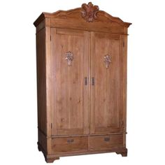 Antique Armoire With Carved Details