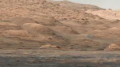 Spectacular photos from space MOUNT SHARP ON MARS  This view from the Mast Camera on NASA's Curiosity Mars rover shows dramatic buttes and layers on the lower flank of Mount Sharp. It is a mosaic of images taken on the 387th Martian day, or sol, of Curiosity's work on Mars.