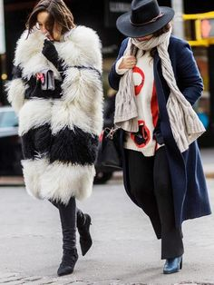 Left, a black and white fur coat is paired with leather boots. Right, a navy blue coat is paired with a scarf, colorful sweater, fedora, wide-leg pants, and boots