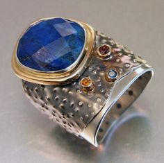 THE RING  Sterling silver, 14k yellow gold, lapis lazuli, sapphire, hessonite garnet, patina.