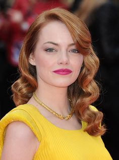 Pin for Later: Spidey Who? Emma Stone Dazzles on Red Carpets Around the World London Premiere Emma intensified the look of her fiery red hair by wearing a bright fuchsia lip and yellow dress at the London premiere.