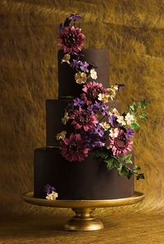 Chocolate-covered bridal shower cake via Cake Central. Perfect for fall with a cascade of purple flowers and ivy.