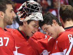 Carey Price (L) and Sidney Crosby of Canada celebrate their hockey gold medal win against Sweden at the Sochi 2014 Winter Olympic Games, Feb...