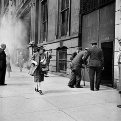 Street 1: Gallery of photos taken by the photographer Vivian Maier. One of multiple galleries on the official Vivian Maier website.