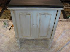Fake French Country Furniture, The Side Table. She uses shoe polish to age the table. I've used shoe polish for similar jobs and it works! Love it! Kiwi black or brown.