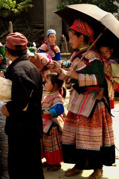 Mother and child of the Hmong Tribe in traditional dress at the market in BacHa near Sapa - Northern Vietnam
