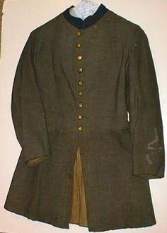 Confederate Enlisted Frock Coat. Much rarer than an Officer's frock coat. Gray wool with blue facing on collar for Infantry. Nine button front. A Federal soldier recovered this early war, single breasted frock coat from the abandoned Confederate trenchline in Little Rock, September 1863.