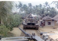 Tanks from 3rd platoon, C company, 1/69th Armor, pass through a village in Binh Dinh province in late 1968.Submitted by a veteran.